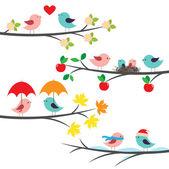 Pájaros y ramas estacionales — Vector de stock