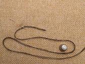 Needle and thread — Stock Photo