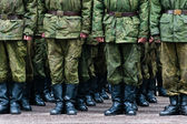 Soldiers stand in formation legs only — Stock Photo