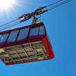 Ropeway wagon moving to the peak — Stock Photo