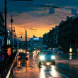 Cars on wet road at night — Stock Photo