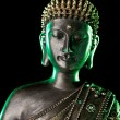 Buddha statue with glow - Stock Photo