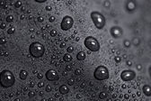 Lotus effect with water drops on black textile — Stock Photo