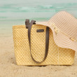 Summer beach bag with straw hat — Stock Photo