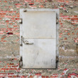Weathered security door - Stock Photo