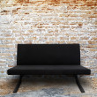 Modern sofa in old brick wall room — Stok fotoğraf