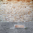 Brick wall outdoors setting - Stock Photo