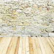 Stone wall with wooden floor - Stock Photo