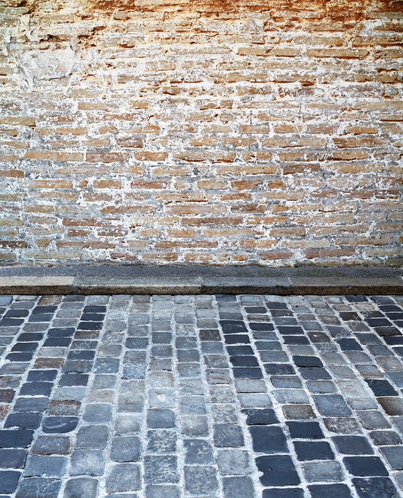 Brick wall and cobblestone street setting — Stock Photo #11236173