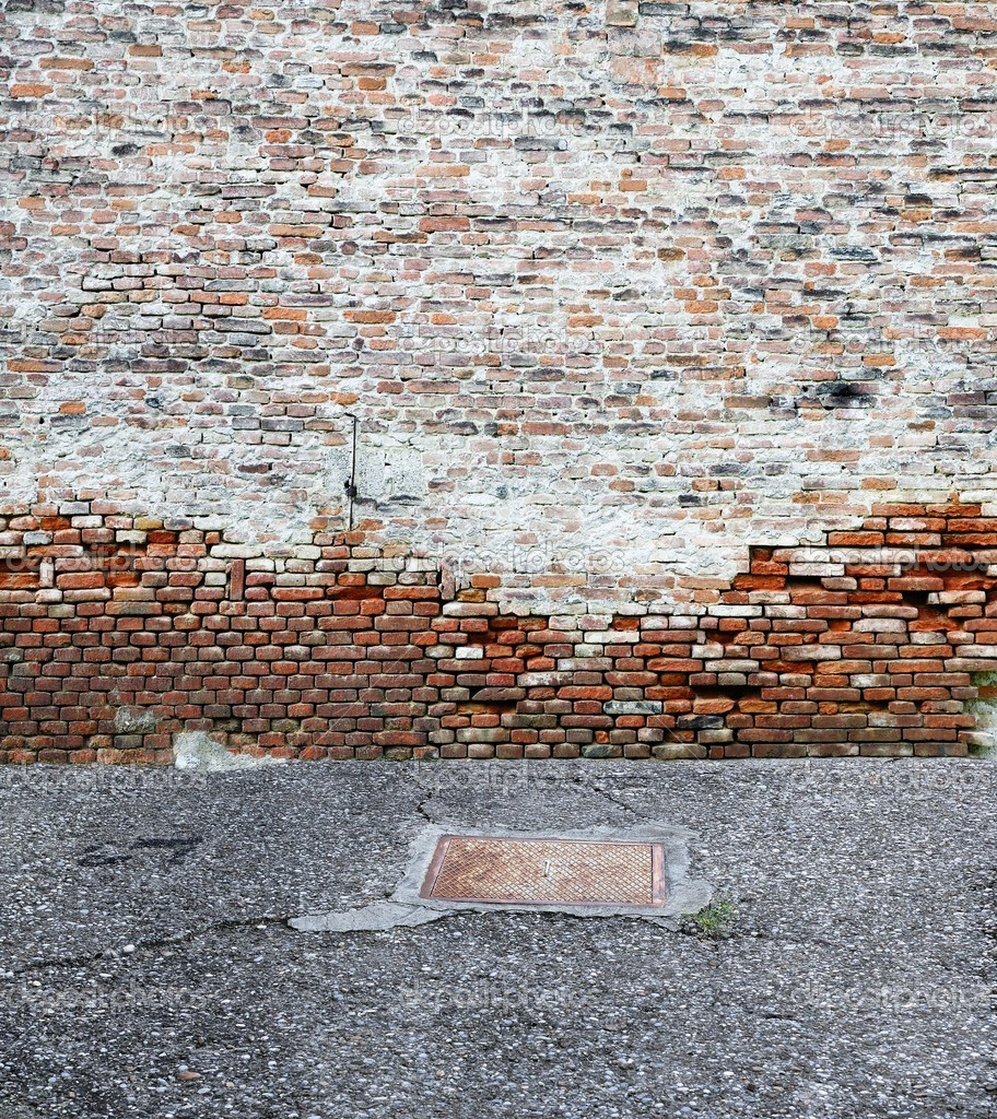 Old brick wall with asphalt  Foto de Stock   #11262624