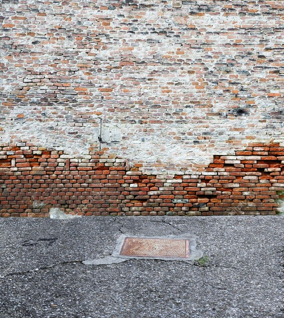 Old brick wall with asphalt — Photo #11262624
