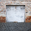 Roll up garage door on brick wall — ストック写真