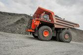 Orange mining vehicle — Stock Photo