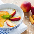 Oatmeal porridge with fresh nectarines - Stock Photo