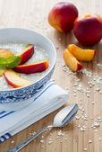 Oatmeal porridge with fresh nectarines — Stock Photo
