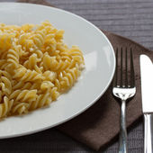 A plate with cooked pasta fusilli — Stock Photo