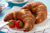 Breakfast with two croissants — Stock Photo