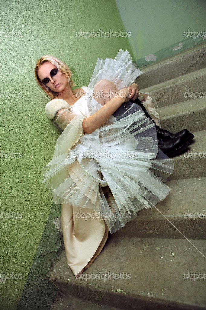 Beautiful young blond girl dressed like a gothic bride on the stairs. — Stock Photo #11222213