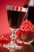Glass of red fruit wine — Stock Photo