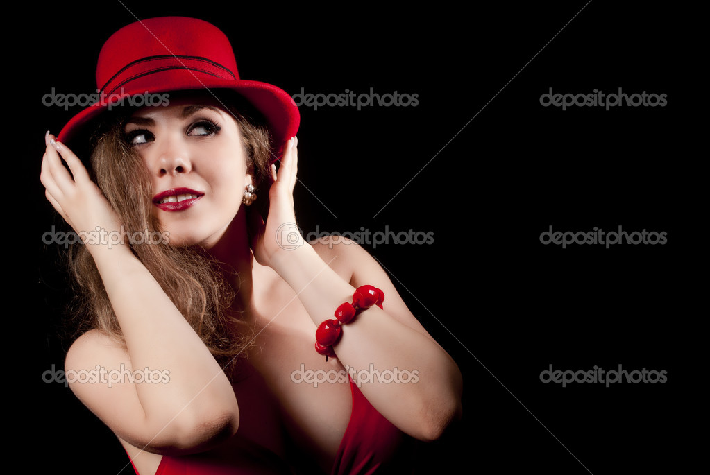 Nice and elegant young woman with a red hat, smiling. — Stock Photo #11446287