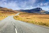 Empty highway through a desolate landscape — Stock Photo