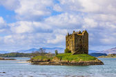 Medieval castle on a island in the water — Stock Photo