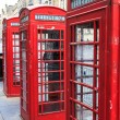 Traditional red phone booth in england — Stock Photo #12324508