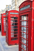 Traditional red phone booth in england — Stock Photo