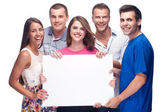 Group of holding a blank billboard — Stock Photo