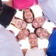 Young happy friends with heads together in circle — Stock Photo