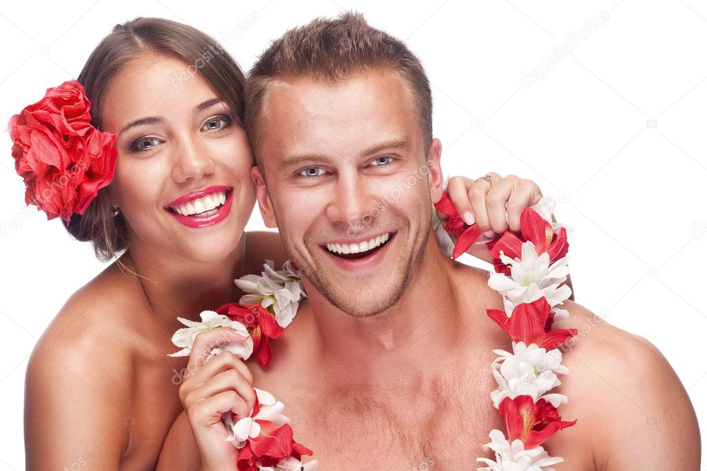 An attractive couple enjoying their honeymoon on a tropical vacation. Isolated on white background — Stock Photo #11370508