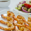 Stock Photo: Chili prawn skewers close-up