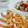 Chili prawn skewers close-up - Stock Photo