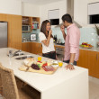 Young couple in modern kitchen — Stock Photo
