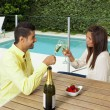 Young couple toasting with champagne — Stock Photo