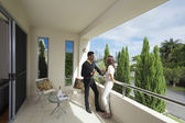 Young couple on balcony — Stock Photo