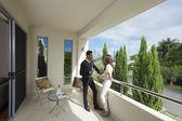 Young couple on balcony — Stock Photo