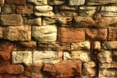 Weather damaged stone wall in need of repair — Stock Photo