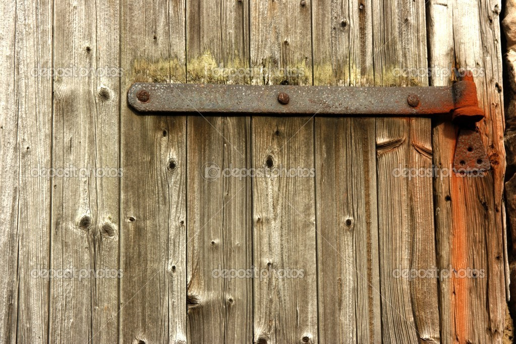 Plain Wooden Door With Rusty Hinge Background and texture design with space for text and image. — Stock Photo #10944663