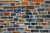 Colourful stones in wall — Stock Photo