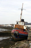 Old tug beached on the quayside — Stock Photo