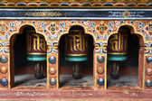 RICH DECORATED PRAYER WHEELS IN PARO RINPUN DZONG - PARO - BHUTAN — Stock Photo