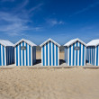 Stockfoto: White and blue striped beach house on sunny beach in France