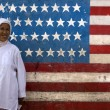 Javanes Islamic woman in front of an American flag - Stock Photo