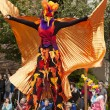 Stilt Walker In Bird Costume - Stock Photo