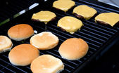 Cheeseburgers Cooking On The Barbeque — Stock Photo