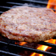 Burger Cooking On The Grill - Stok fotoğraf