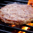 Burger Cooking On The Grill - Stock Photo
