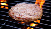 Burger Cooking On The Grill — Stock Photo
