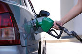 Petrol pump filling — Stock Photo
